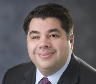 GEORGE J. TSUNIS